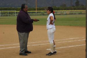 Ed Castro interviewing a softball athlete. (Photo courtesy of @Softball4Life43)